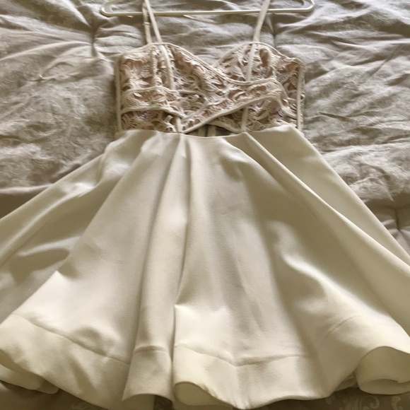 Luxxel Dresses & Skirts - Adorable white dress, lace detailing along bust